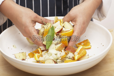 person mixing the stuffing close up