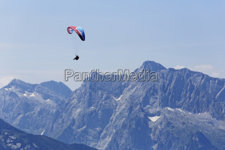 germany bavaria paraglider flying over berchtesgaden
