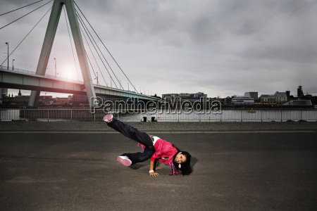 germany cologne young woman performing break