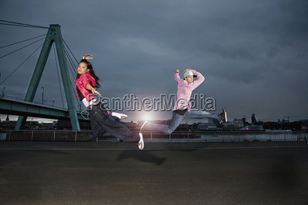 germany cologne man and woman jumping