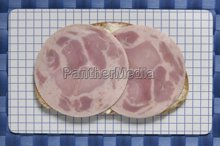 slice of bread with ham sausage