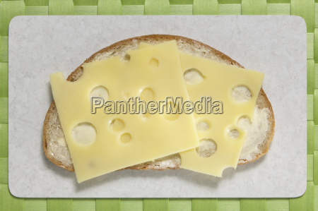 slice of bread with cheese elevated