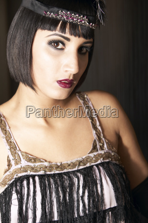 young woman wearing glamorous clothes portrait