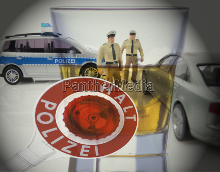stop police sign and policemen figurines