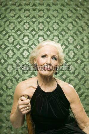 senior woman sitting on chair looking