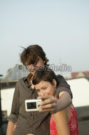 young couple photographing self