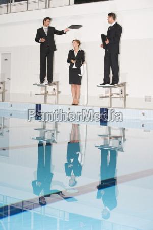 businessmen standing on starting blocks one