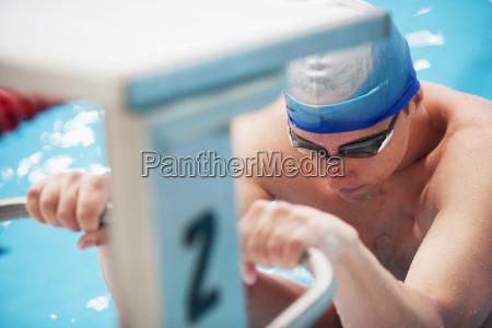 swimmer at starting block