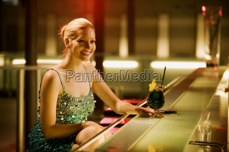 young woman sitting in bar cocktail
