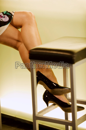 female legs at bar counter low