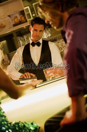 young couple in bar barkeeper in