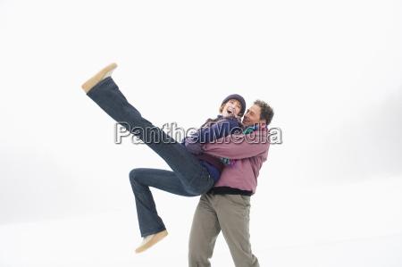 italy south tyrol seiseralm man lifting