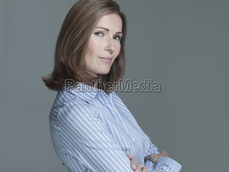 woman arms crossed side view portrait