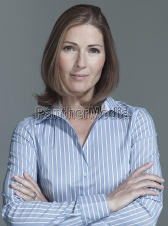 woman arms crossed portrait close up