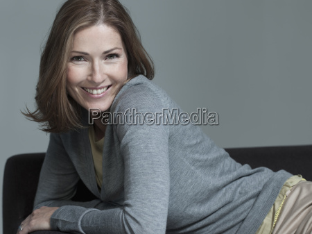 woman on sofa smiling portrait