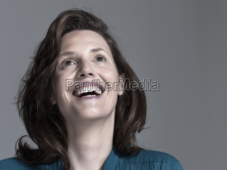 woman looking up laughing portrait