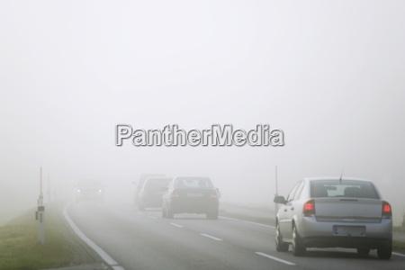 traffic on road in mist