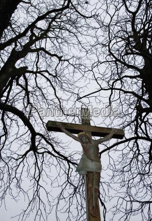 austria salzkammergut oberhofen cross between trees