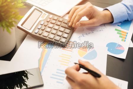 businesman working on stock market graphs