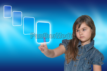 little girl is touching ransparent rectangle
