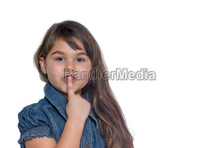 portrait of little girl gesturing shush