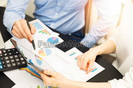 business people discussing financial data results