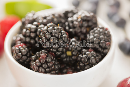 close up of blackberries in bowl