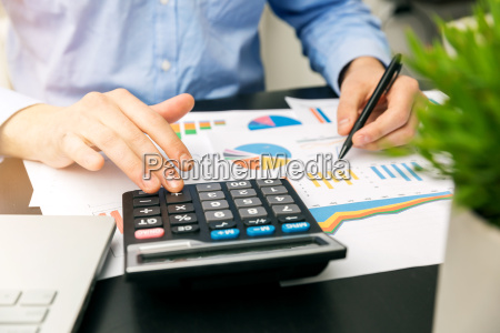 businessman analyzing financial graphs and reports