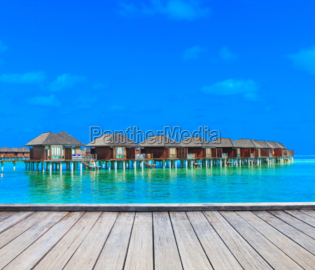 beach with water bungalows maldives