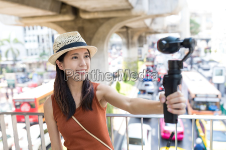 woman using video camera for taking