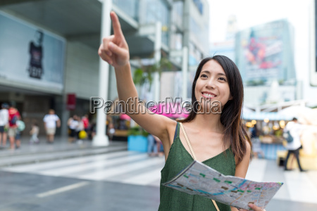 woman using city map and finger