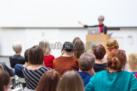woman giving presentation on business conference