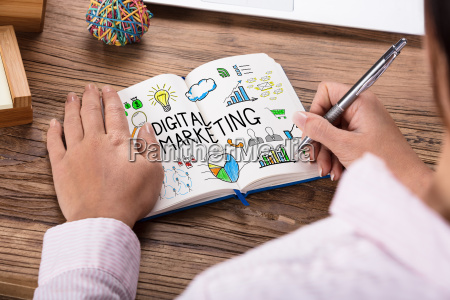 businessperson drawing digital marketing concept on