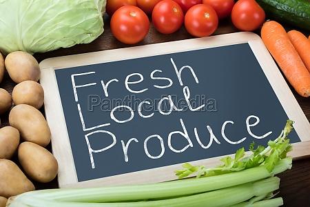 fresh local produce written on slate