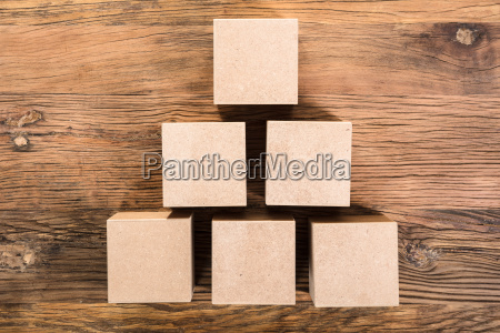 wooden cube arranged in pyramid shape