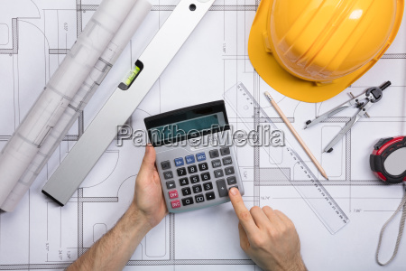 architect hands using calculator working on