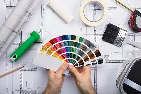 ein architekt holding color guide swatch