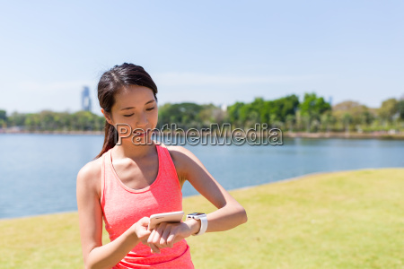 young woman using smart watch and