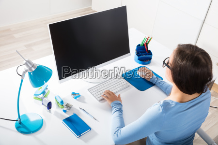 businesswoman using computer on desk