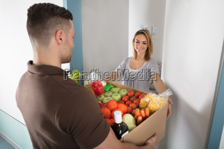 delivery man holding groceries