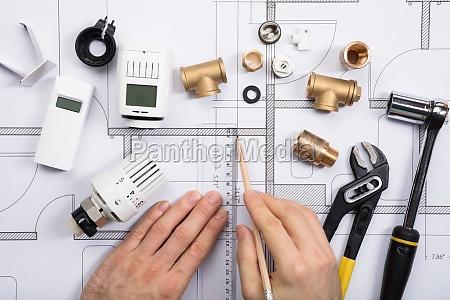 an architect drawing plan on blueprint
