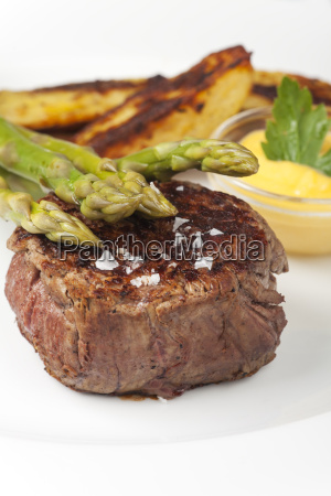 beef steak and asparagus with potatoes