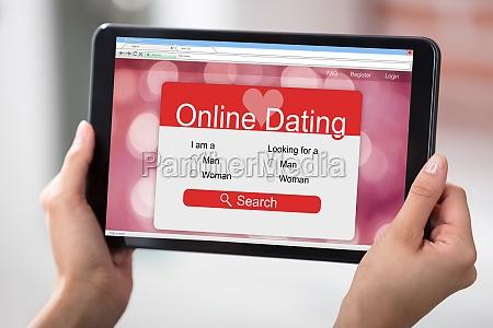 digital tablet screen showing online dating