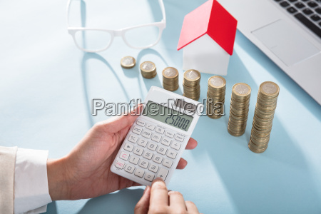 businesswoman calculating finance