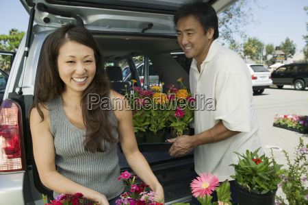 woman with husband loading flowers