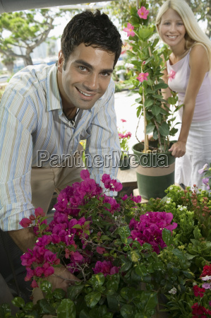 couple selecting flowers at plant nursery