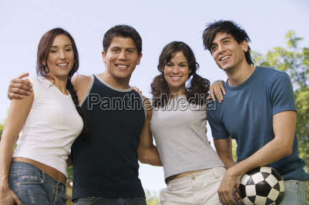 four young people at park man