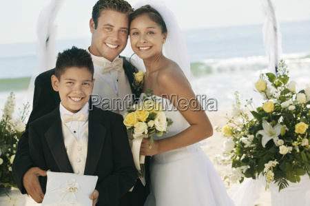 couple with boy holding rings at