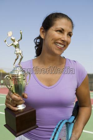 mid adult female tennis player on
