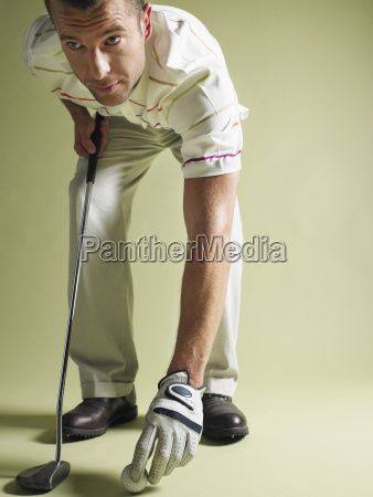 golfer with club and ball